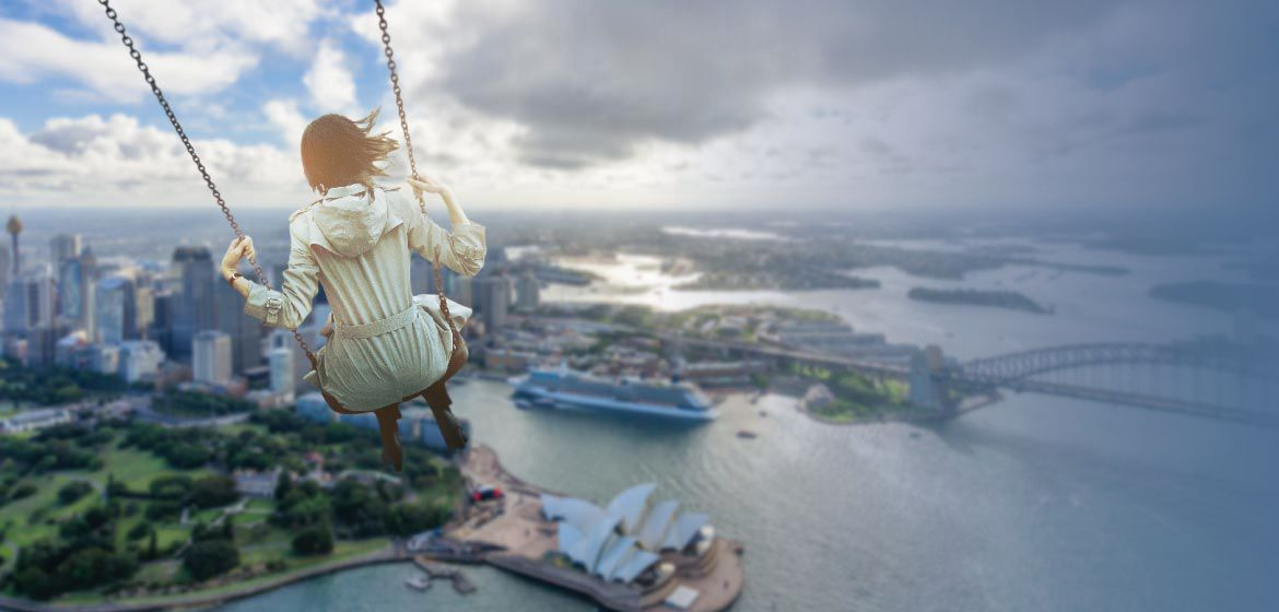 A girl swinging over Sydney