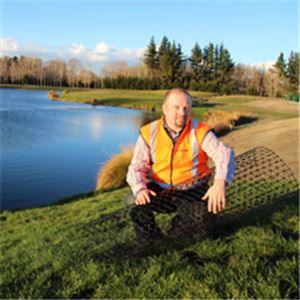 Dr Jan Kupec, with a small roll of geogrid, as was used on the Isaac Lakes development at Clearwater, Christchurch