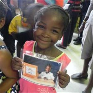 A picture of a child at Olievenhoutbosch Christian School with her photograph