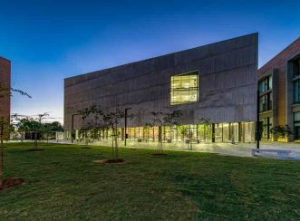 Sharp, angular facade of the Sol Plaatje University Library and Student Resources Centre at night. Aurecon provided structural, civil, electrical, fire and wet services design for the project.