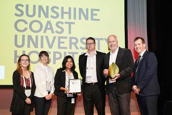 Accepting the award for Sunshine Coast University Hospital L to R: Amy Louise Kitchingman (University of South Australia); Rachael Rose Mcfadyen (University of South Australia); Aditi Saha (Aurecon); Ross Tucker (Lendlease); Don Glynn (Queensland Health); and Darryl Pitcher (IFHE)