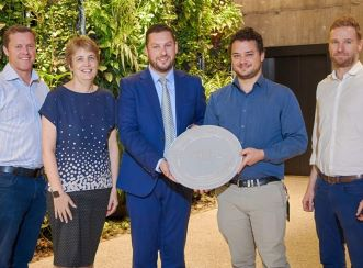 Jack Noonan from the International WELL Building Institute (IWBI) presenting the Platinum WELL Core and Shell Certification to the Aurecon team: Chris Ammundsen, Evelyn Storey, Luke McKenzie and Nicholas Weiske.