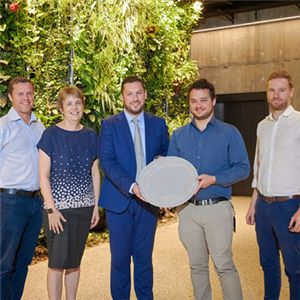 Jack Noonan from the International WELL Building Institute (IWBI) presenting the Platinum WELL Core and Shell Certification to the Aurecon team: Chris Ammundsen, Evelyn Storey, Luke McKenzie and Nicholas Weiske