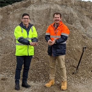 RAAF Williams Point Cook base Manager Peter Nadler (left) standing with Aurecon Senior Program Advisory Consultant Ryan Chirgwin (right) near the stockpile of crushed concrete on site that is being used in the new carparks and pavements.