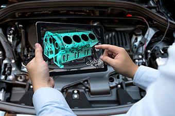 A model of a car engine on a tablet