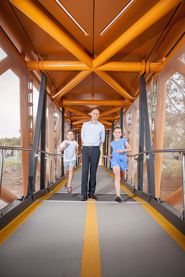 Arne Nilsen and his children walking the ferry gangway