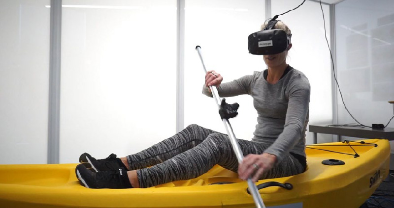 Exhibition visitors sat in a stationary kayak and lowered virtual reality goggles over their eyes to be transported onto a conceptual river, gliding over the water.