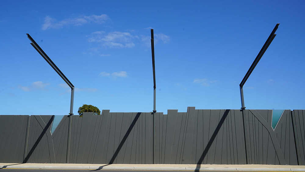 Walls that are between 3 – 3.5m high were erected to reduce the sound pollution from construction.