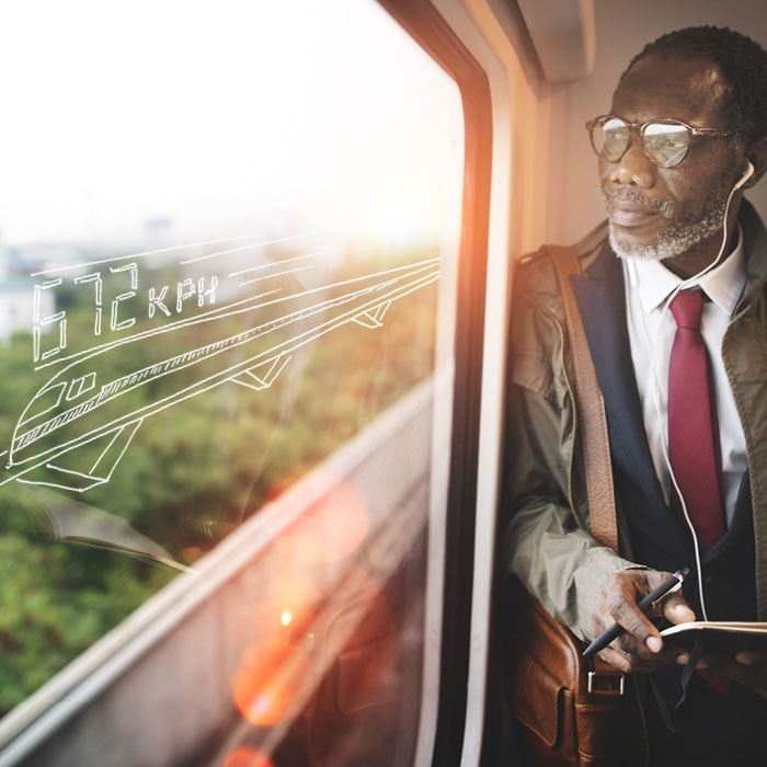 Aurecon: consulting engineers - A man riding a train in the future