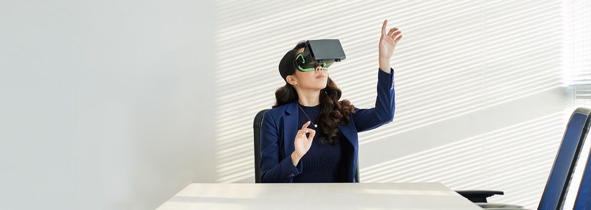 Asian woman in boardroom using VR