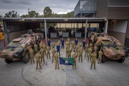 Australian Army soldiers undertaking training of the new Boxer Combat Renaissance Vehicles gather for a photo. Image courtesy of Australian Government Department of Defence.
