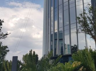 The glass facade of One Discovery Place