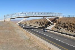 The Qunu pedestrian bridge provides a safe route