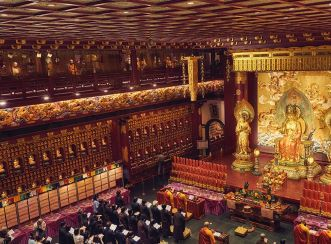 Subtle lighting creates worshipful atmosphere inside the Buddha Tooth Relic Temple main prayer hall - photo  by John Scott